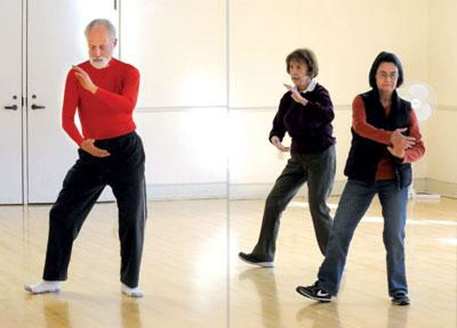 Martin Reichgut of Milford teaches the Tai Chi classes at the Nathaneal B. Greene Community Center in Guilford including this intermediate class with Eve Struve center and Eleanor Weissberg right. (Photo by Mara Lavitt/New Haven Register)