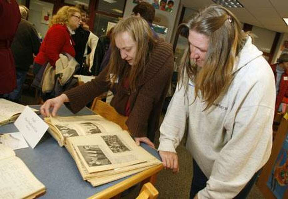 Dispatch Staff Photo by JOHN HAEGER (Twitter.com/OneidaPhoto)Jeanne Trexler Fox and Lori Bowman look through old newspaper clippings of North Broad Street Elementary School during an open house to celebrate the school's 100th anniversary on Thursday, Dec. 1, 2011