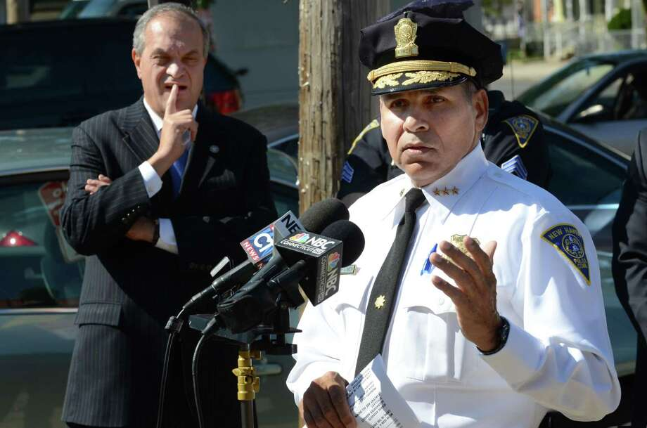 Police Chief Frank Limon with Mayor John DeStefano Jr.  looking on from the background discusses New Haven crime stats for the first half of 2011 with news media. VM Williams 10.06.11