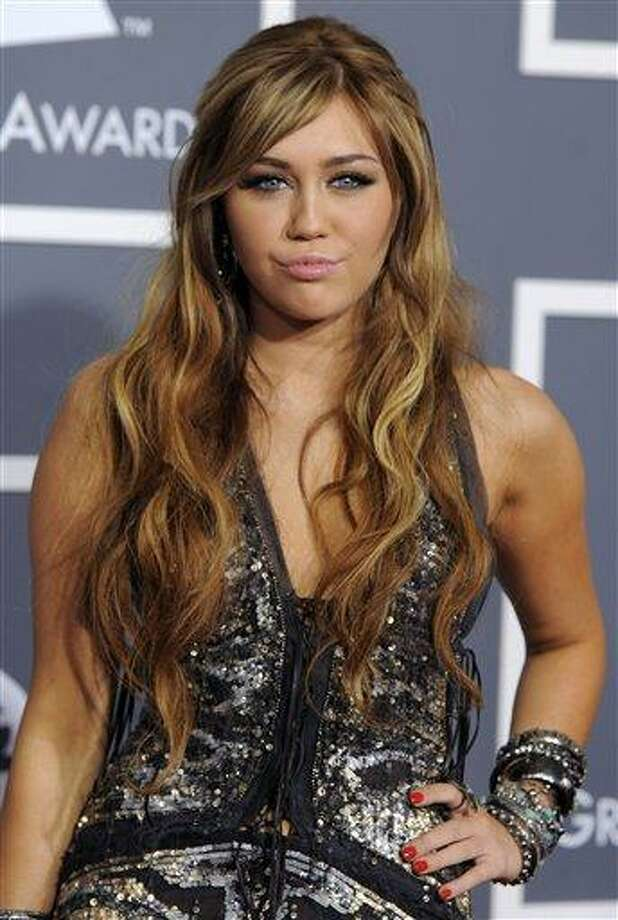 Miley Cyrus arrives at the 53rd annual Grammy Awards on Sunday, Feb. 13, 2011, in Los Angeles. (AP Photo/Chris Pizzello) Photo: AP / AP