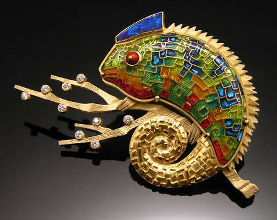 Amy Roper Lyons' work is a love song to the marvelous variety of form and color found in the natural world. One of America's foremost jewelry designers and enamelists, she returns to Paradise City after a five-year hiatus. A master of cloisonne and basse-taille, Lyons creates bold compositions of gold and glass distinguished by luscious colors and exquisite workmanship.  Her work has been published in numerous magazines and books, and she is the winner of the Couture Award, the Saul Bell Design Competition and several First Place Niche Awards. / Copyrighted Permission granted by Paradise City, Inc 2008 www.paradisecityarts.com
