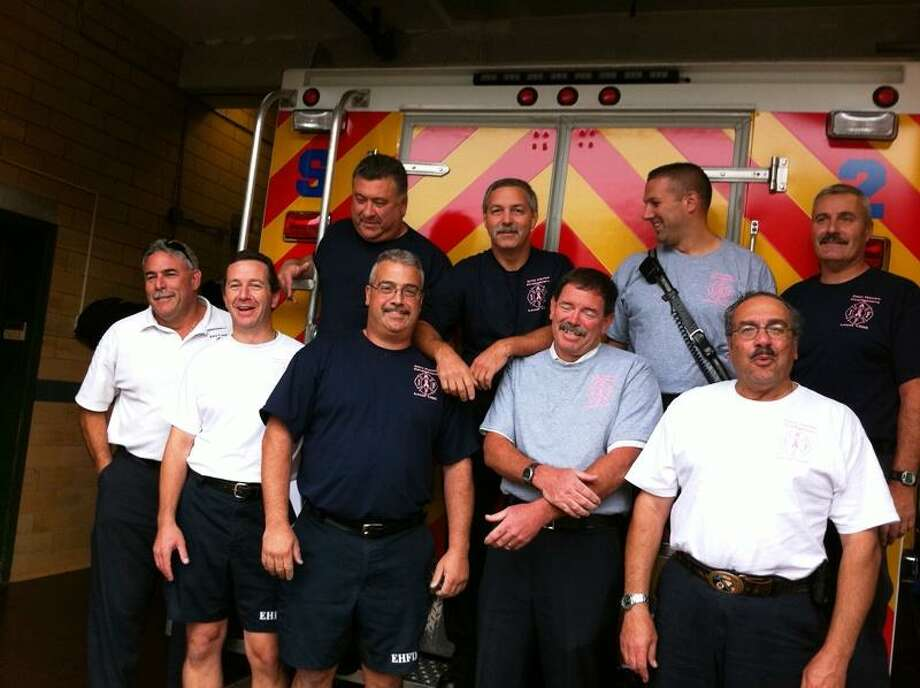 East Haven firefighters sporting shirts to raise money for fight against breast cancer. Mark Zaretsky/Register.