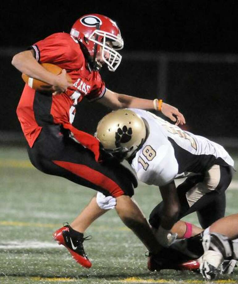 Michael John Ecke of Cheshire, left, is tackled by Hand's Andrew Federico during the first quarter at Falcon Field in Meriden. Hand beat Cheshire 31-14.  Photo by Peter Hvizdak / New Haven Register    October 6, 2011       ph2379               #     Connecticut