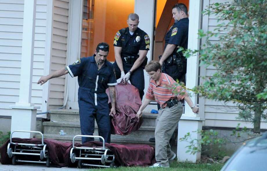 One of two bodies from an apparent murder-suicide is taken out of a third-floor unit at 179 Knollwood Drive in Wallingford Wednesday evening by town police and personnel from the state medical examiner's office. Peter Hvizdak/Register