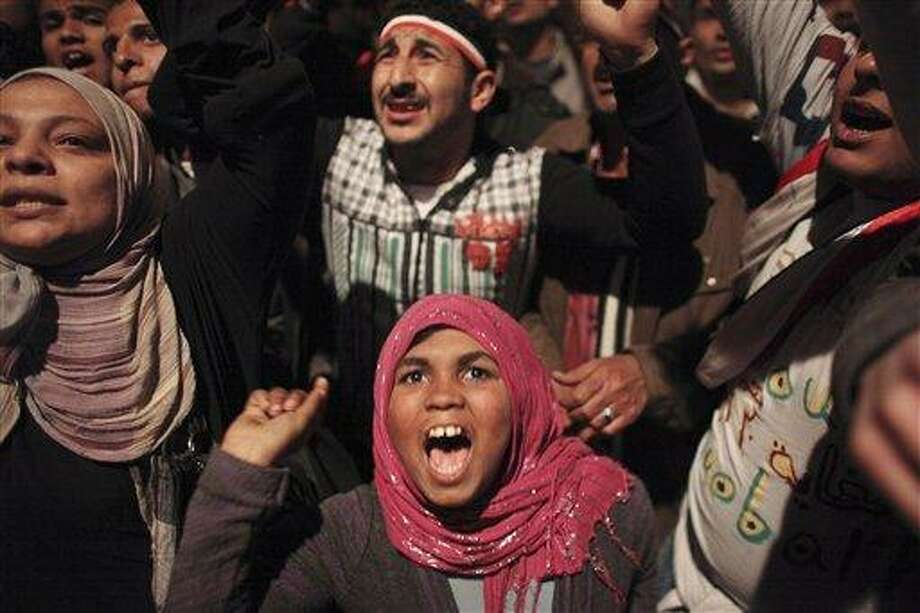 An Egyptian girl celebrates the news of the resignation of President Hosni Mubarak, who handed control of the country to the military, at night in Tahrir Square in downtown Cairo, Egypt, Friday. (AP Photo/Tara Todras-Whitehill) Photo: ASSOCIATED PRESS / AP2011
