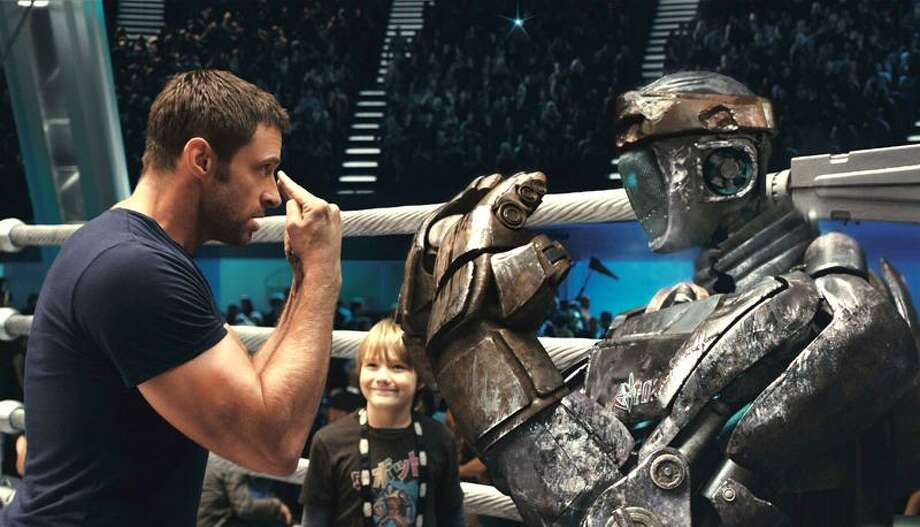 Disney/DreamWorks II: Hugh Jackman, left, and Dakota Goyo share a father, son, robot moment. Photo: AP / ©DreamWorks II Distribution Co., LLC. ÊAll Rights Reserved.