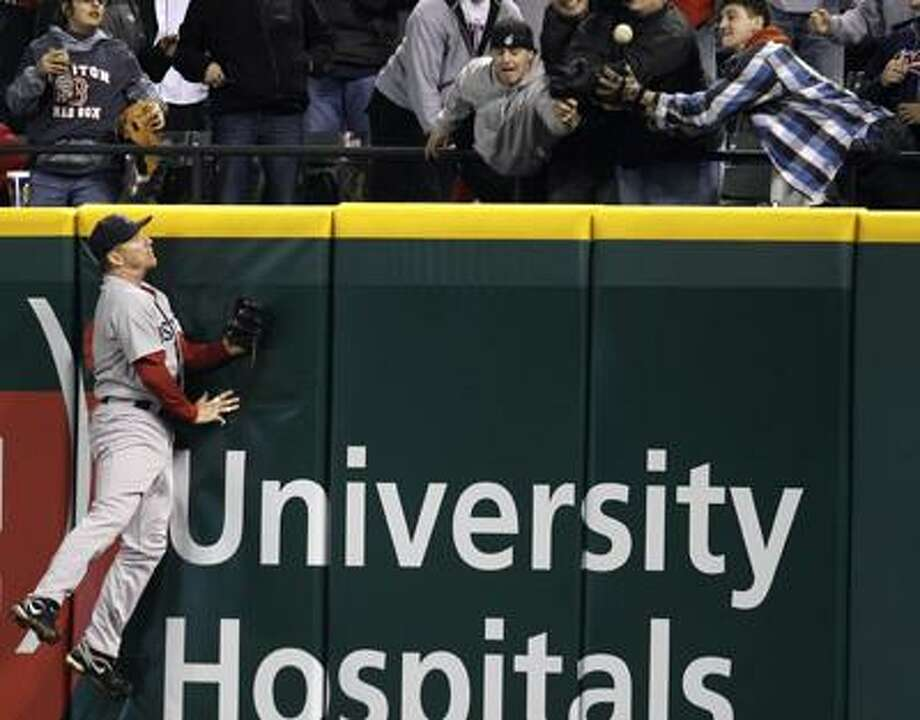 Boston Red Sox right fielder J.D. Drew jumps high but cannot reach a three-run home run hit by Cleveland Indians' Asdrubal Cabrera in the sixth inning in a baseball game, Wednesday, April 6, 2011, in Cleveland. (AP Photo/Tony Dejak) Photo: AP / AP 2010