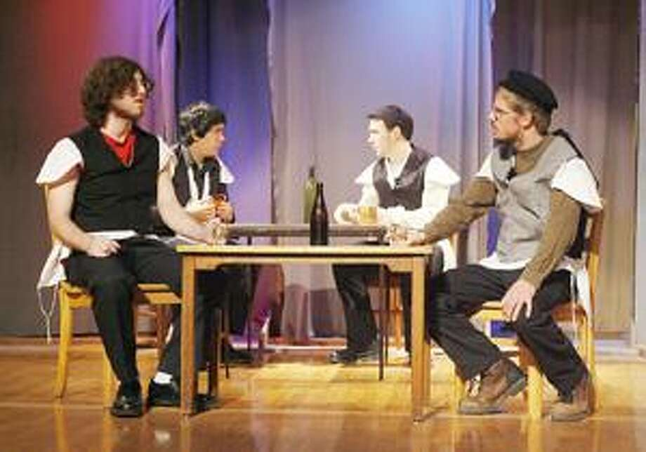"""Photo by JOHN HAEGER Jacob Rudolph, Alex Wenham, Tyler Langbein and Alex Galler rehearse a scene from the Madison Drama Club production of """"Fiddler on the Roof"""" on Saturday, April 2, 2011 at the school."""