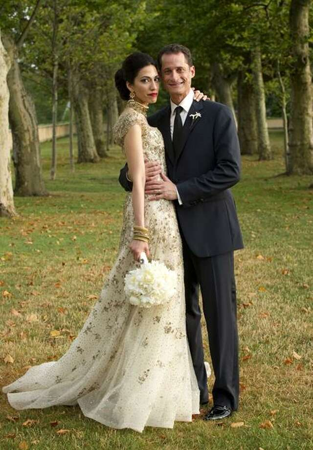 U.S. Rep. Anthony Weiner, D-N.Y., poses with his wife, Huma Abedin, for a formal wedding portrait in July, 2010. Associated Press Photo: AP / MARIE TERNES