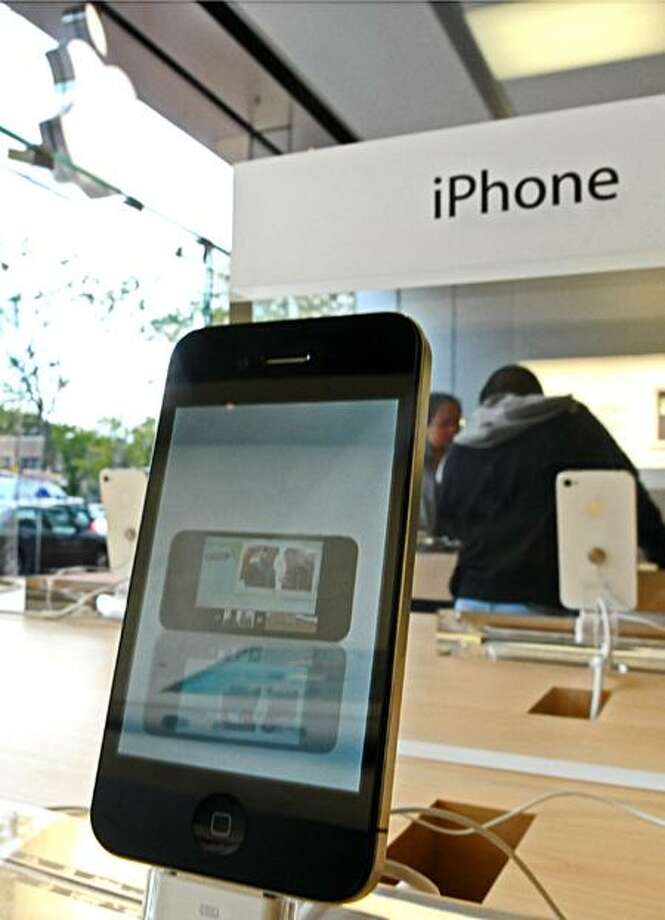 An iPhone4 model is displayed at the city store on Broadway. Peter Hvizdak/Register