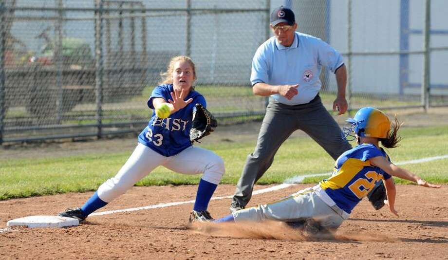 West Haven High School, Class M softball semifinal between East Catholic and Seymour, 5th inning: Seymour's Morgan Scinto slides safely into third on a slow throw to East Catholic's Julia Maloney left. Photo by Mara Lavitt/New Haven Register6/6/11