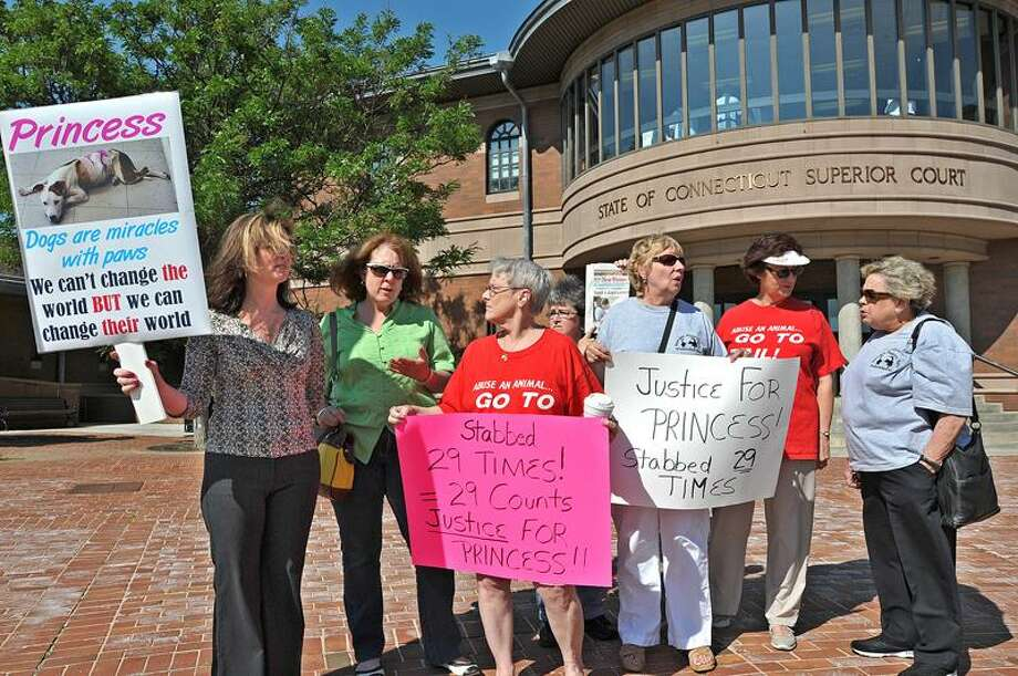 Animal rights activists protest outside Superior Court in Meriden before the arraignment of Alexander P. Bernard, the New Haven man accused of stabbing his dog 29 times. (Peter Casolino/Register)