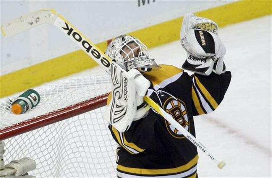 Bruins goalie Tim Thomas celebrates his team's 8-1 win against the Vancouver Canucks in Game 3 of the Stanley Cup Finals in Boston on Monday. (AP photo) Photo: AP / AP