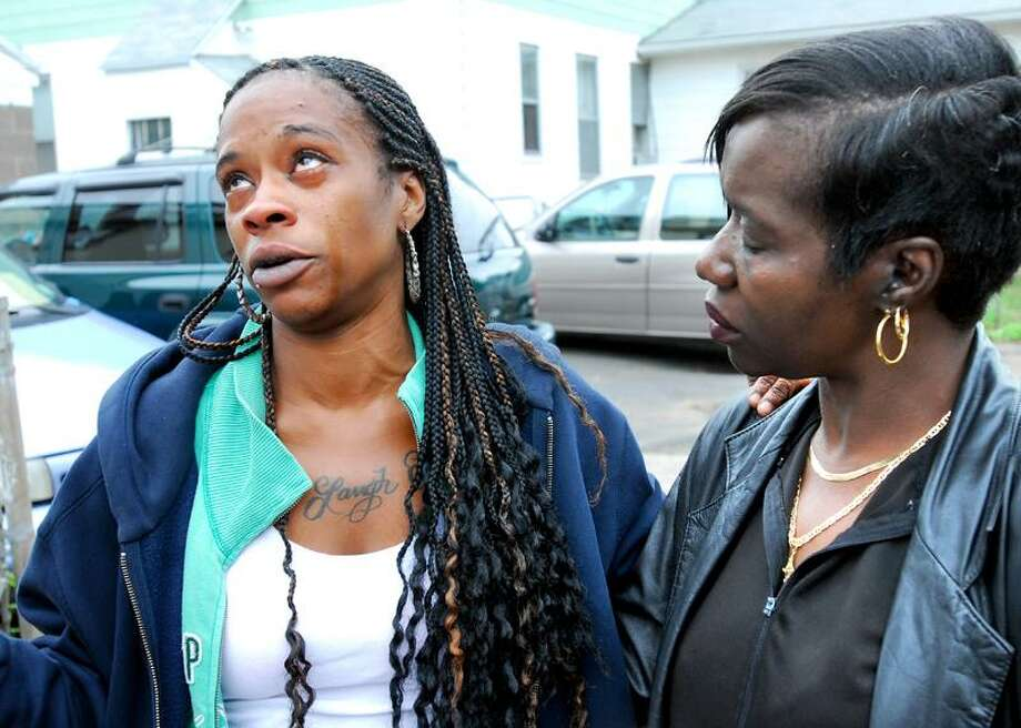 Erica Hobdy, left, talks about the death of her niece Neveah Angel Bryant in front of her home at 127 Leete St. in West Haven Monday. At right is Hobdy's mother, Gwenda Bryant of Alabama, who is Neveah's grandmother. (Arnold Gold/Register)