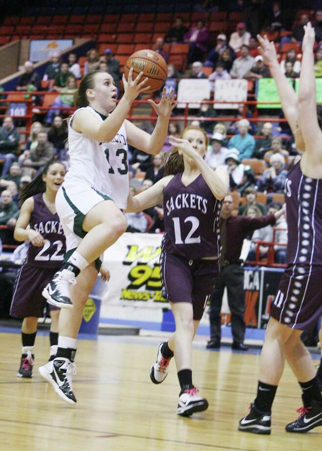 Dispatch Staff Photo by JOHN HAEGERHamilton's Jordan Peterson (13)  drives up the middle for two as Sackets Harbor's defends in the first half of the Sec III Class D finals in Utica on Sunday, March 6, 2011. Hamilton won the game in overtime to advance to regional play.