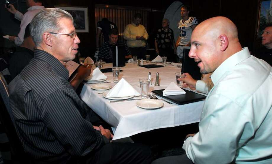 Head football coaches Rich Cavanaugh (left) of Southern Connecticut State University and Peter Rossomando (right) of the University of New Haven talk before dinner at Carmine's Tuscan Grill Ristorante in New Haven on 10/3/2011.Photo by Arnold Gold/New Haven Register   AG0425F