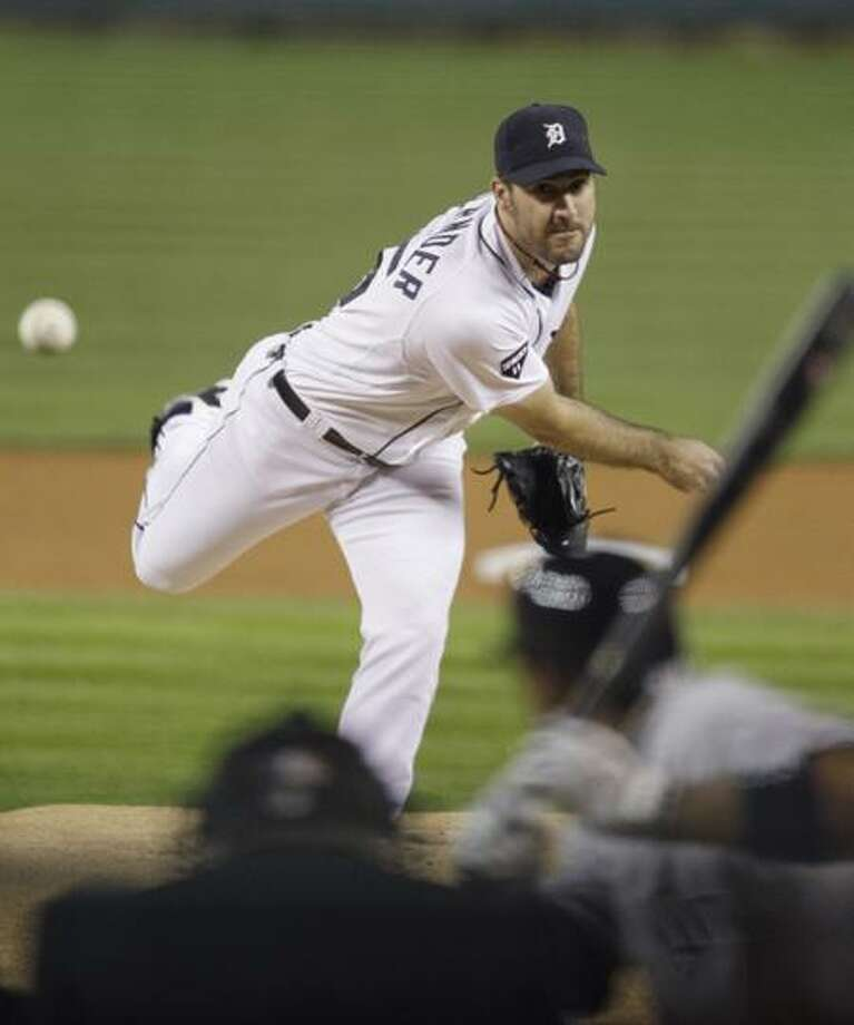 Detroit Tigers starting pitcher Justin Verlander throws during the first inning of Game 3 of baseball's American League division series against the New York Yankees on Monday, Oct. 3, 2011, in Detroit. (AP Photo/Carlos Osorio) Photo: AP / AP2011