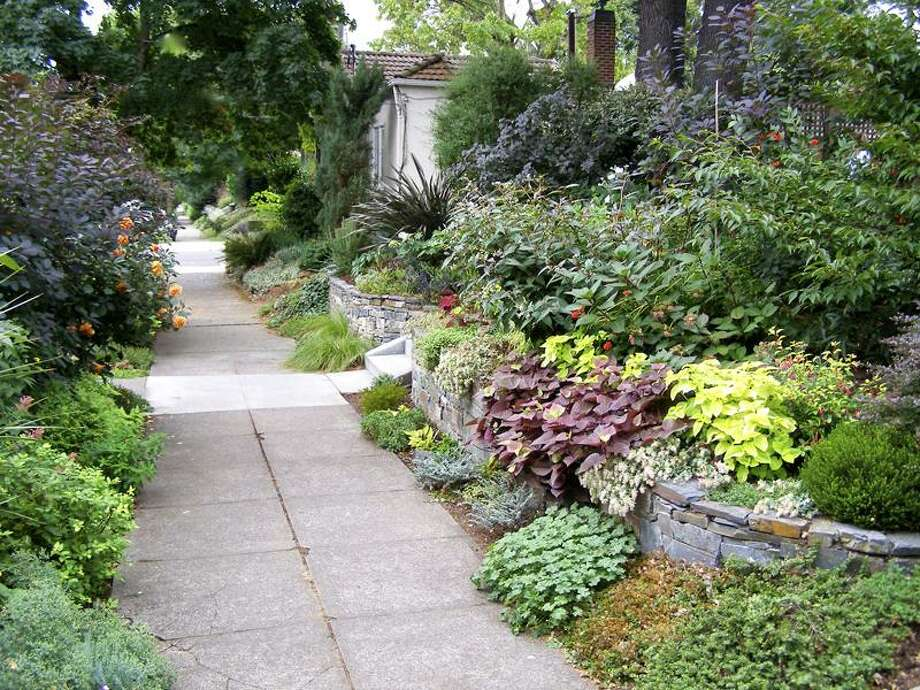 """SH11E177GARDENER May 30, 2011 -- A well-designed landscape will boost a home's """"curb appeal,"""" whether you're trying to sell your house or buying a fixer-upper. (SHNS photo courtesy Glen Seibert)"""
