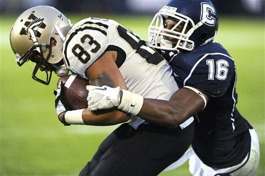 Western Michigan's Jordan White (83) scores a touchdown under pressure from Connecticut's Byron Jones (16) in the second half of an NCAA college football game, in East Hartford, Conn., on Saturday, Oct. 1, 2011. (AP Photo/Jessica Hill) Photo: AP / AP2011