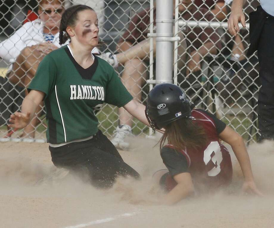 Dispatch Staff Photo by JOHN HAEGERSVCS Mandi Beauvais (3) slides into home on the pass ball under the tag of  Hamilton;s Rebecca Rogers (9)  in the top of the second inning of play  on Saturday June 4, 2011.