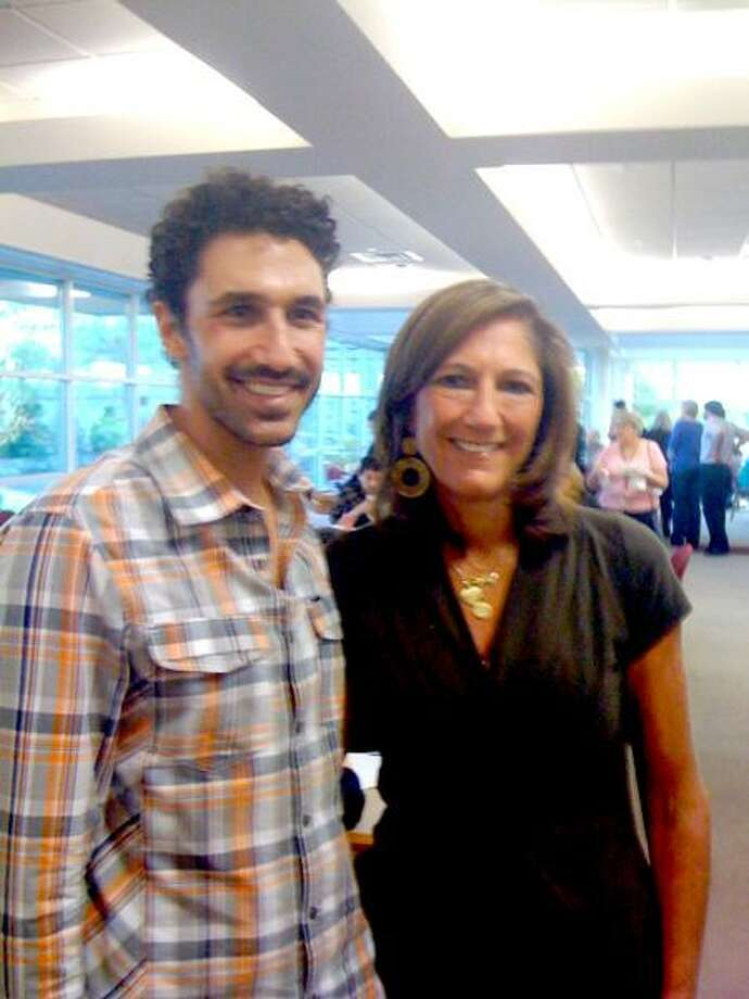 "Contributed photo: ""Survivor: Africa"" star Ethan Zohn strikes a pose with LuAnn Buono of North Haven when he visited for a Yale survivor's program."