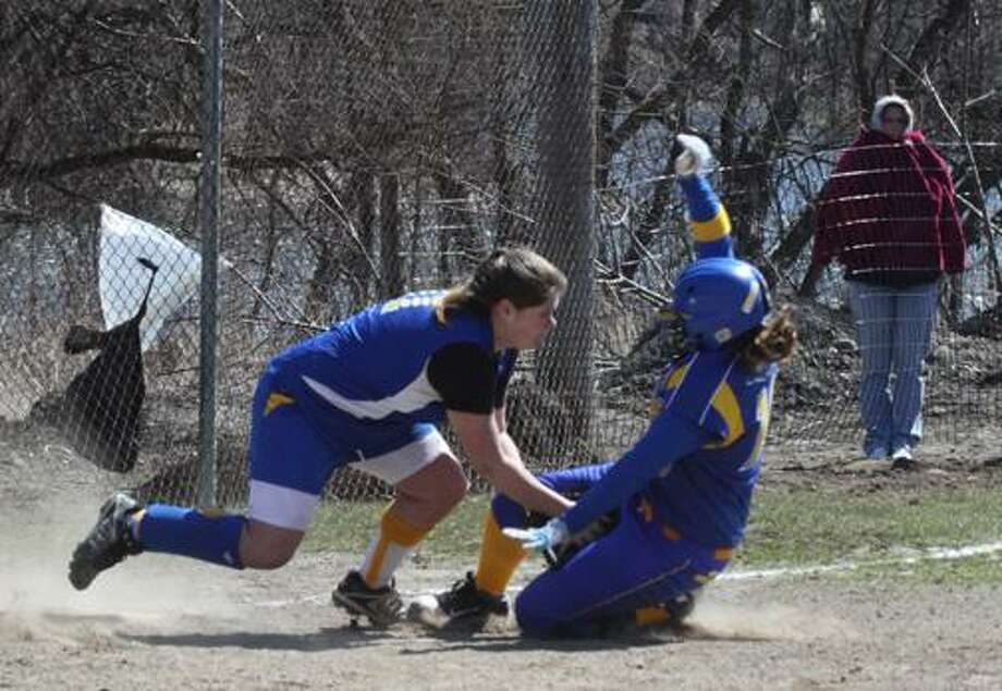 Submitted Photo by Brian C. Horey Madison third baseman Shana Biedermann puts a tag on Schenevus' Megan Teft during a game at Mudville in Herkimer Sunday, April 3, 2011.  Madison lost 32-2 in 5 innings.