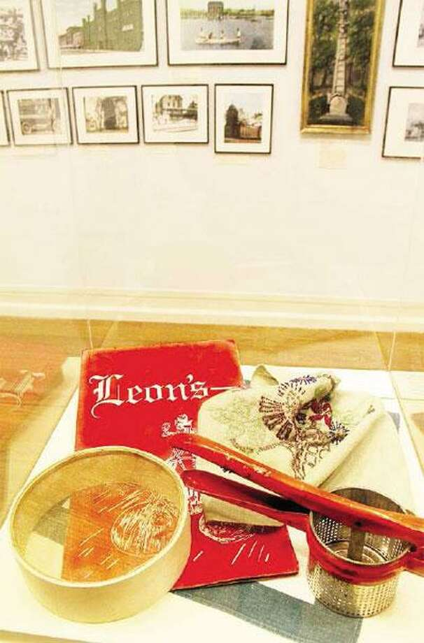 """The New Haven Museum's new exhibit, """"The Hill: New Haven's First Suburb"""" showcases memorabilia from Leon's Restaurant, the famous Hill institution. (NeRonda Langley/For the Register)"""