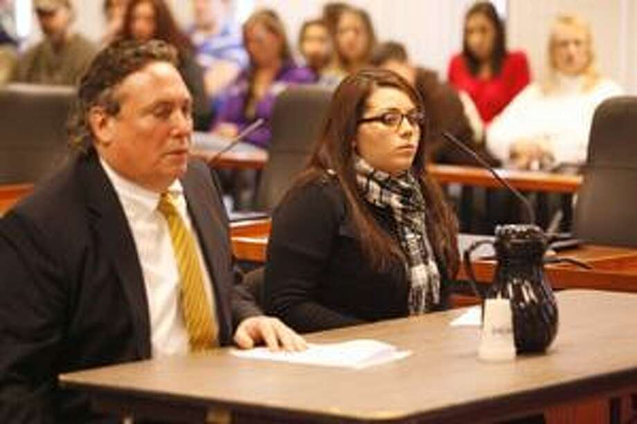 Photo by JOHN HAEGER Chelsea L. Kuss sits with her attorney, Bob Durr, as she is sentenced in Madison County on Monday, Feb. 7, 2011, to 3 1/3 to 10 years in prison in relation to a May 24, 2010 accident that left one person dead and another severely injured.