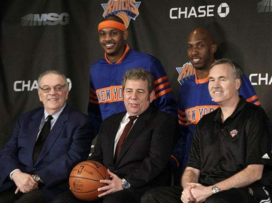 FILE - This Feb. 23, 2011, file photo shows New York Knicks newest basketball players Carmelo Anthony, second from left, and Chauncey Billups, second from right, posing for photographs with team owner James Dolan, center, head coach Mike D'Antoni, right, and team president Donnie Walsh during a news conference before an NBA basketball game against the Milwaukee Bucks,  in New York. The Knicks say in a statement Friday, June 3, 2011,  that Walsh and Madison Square Garden chairman James Dolan have mutally agreed that Walsh will not return when his contract expires at the end of June. (AP Photo/Kathy Willens, File) Photo: ASSOCIATED PRESS / AP2011