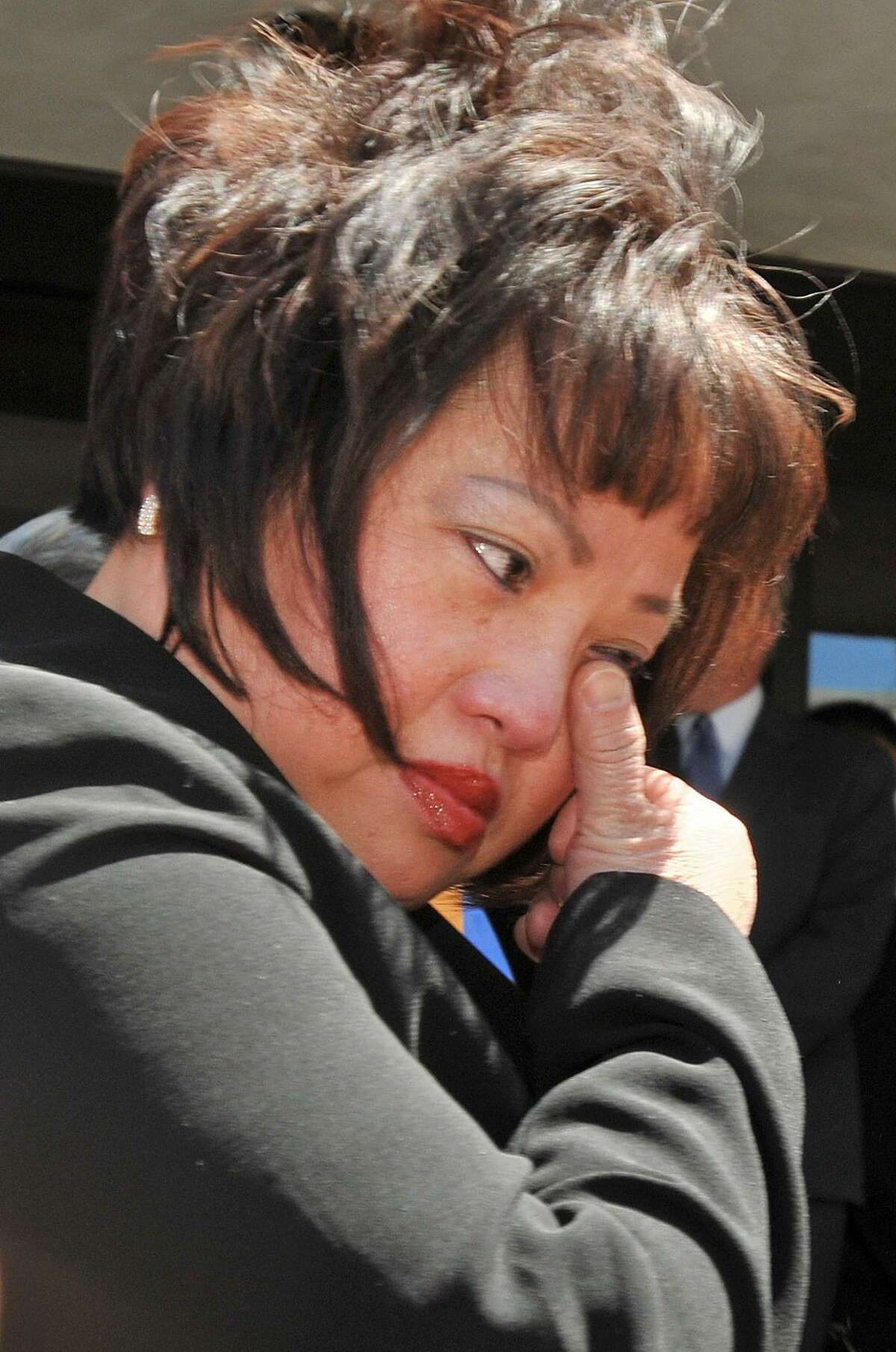 New Haven--Vivian Van Le outside New Haven Superior Court Friday afternoon after the sentencing of Raymond Clark Jr. for the murder of her daughter Annie Le. Photo by Brad Horrigan/New Haven Register-06.03.11.