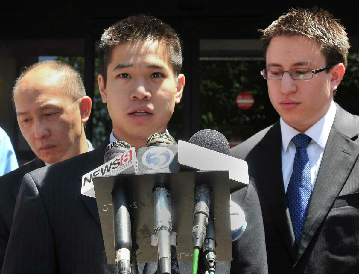 New Haven--Annie Le's brother Chris Le, center, address the media outside New Haven Superior Court Friday afternoon after the sentencing of Raymond Clark Jr. At left is an uncle of Annie Le and at right is Annie Le's former fiance Jonathan Widawsky. Photo by Brad Horrigan/New Haven Register-06.03.11.