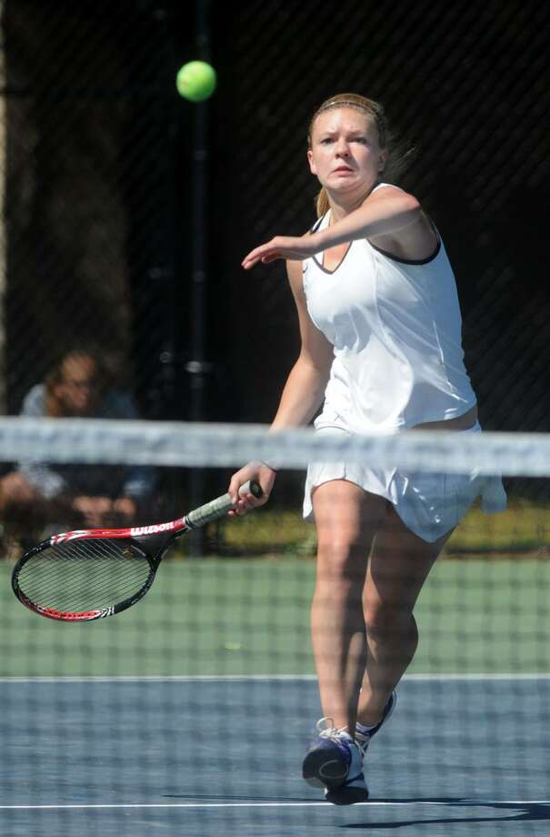 Hand's Rachel Petrini returns to Avon's Catherine Go in the Class M state finals. Photo by Mara Lavitt/New Haven Register