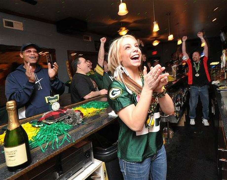 Chelsey Walker, front, cheers for the Packers while working behind the bar at Cooler Near the Lake, in Kenosha, Wis., during the Super Bowl on Sunday evening.(AP Photo/Kenosha News, Sean Krajacic) Photo: AP / KENOSHA NEWS