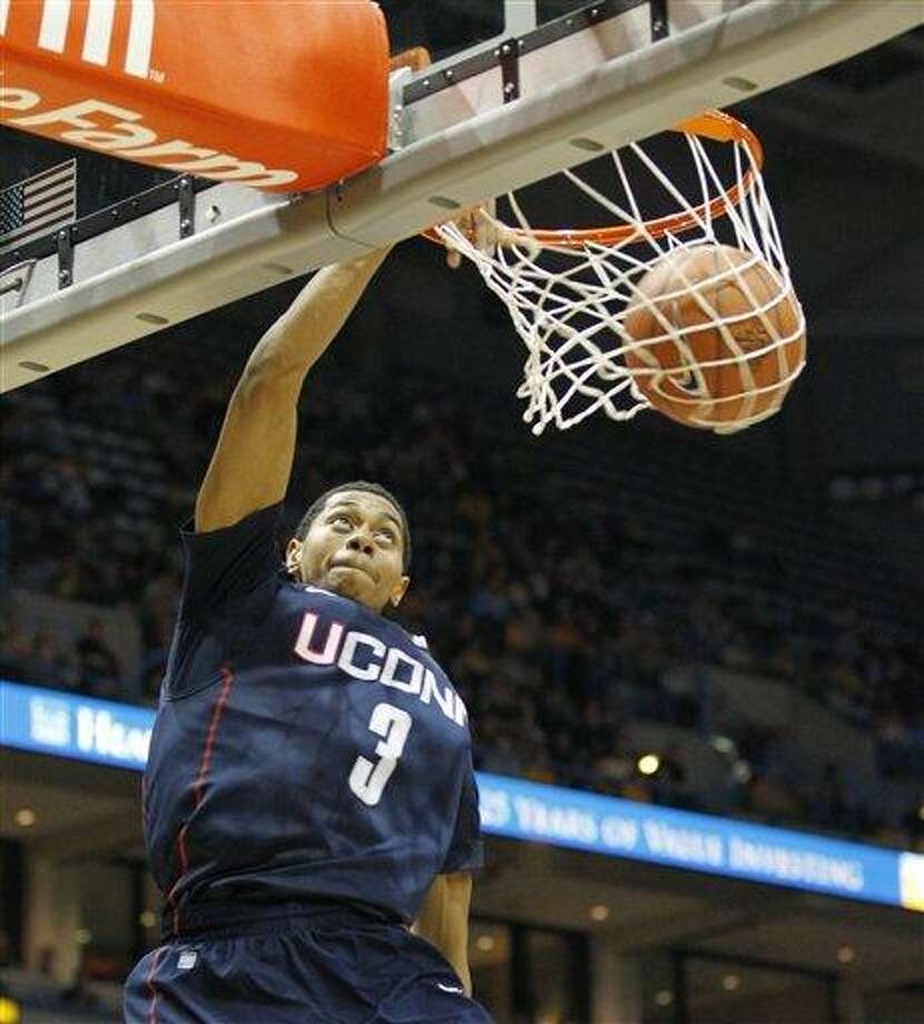 Connecticut's Jeremy Lamb (3) dunks the ball against Marquette in the first half of an NCAA college basketball game Tuesday, Jan. 25, 2011, in Milwaukee. (AP Photo/Jeffrey Phelps) Photo: AP / FR59249 AP