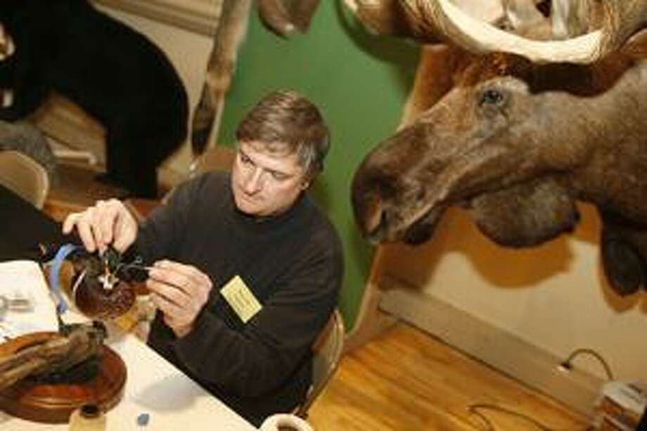 Photo by JOHN HAEGER Second Nature Taxidermy's Paul Bolton of Canastota demonstrates his craft during the CNY Sportsman Show on Saturday, Feb. 5, 2011.