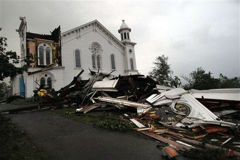 The steeple of The First Church of Monson lay in rubble on the ground after a tornado swept through the downtown area of Monson, Mass., Wednesday, June 1, 2011. (AP Photo/Elise Amendola) Photo: AP / AP