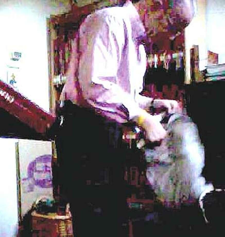 In this video image, John Polletta is shown in a room at the church where he was caught stealing on camera.