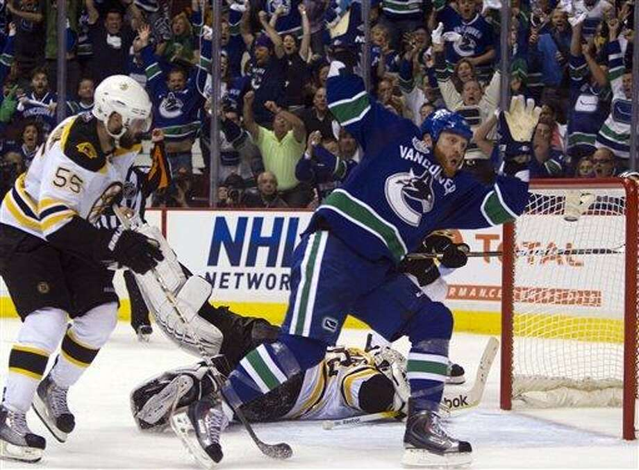 Vancouver's Raffi Torres celebrates after scoring the winning goal with 18.5 seconds left in the Canucks' 1-0 win over the Bruins in Game 1 of the Stanley Cup finals Wednesday. (AP photo) Photo: AP / CP