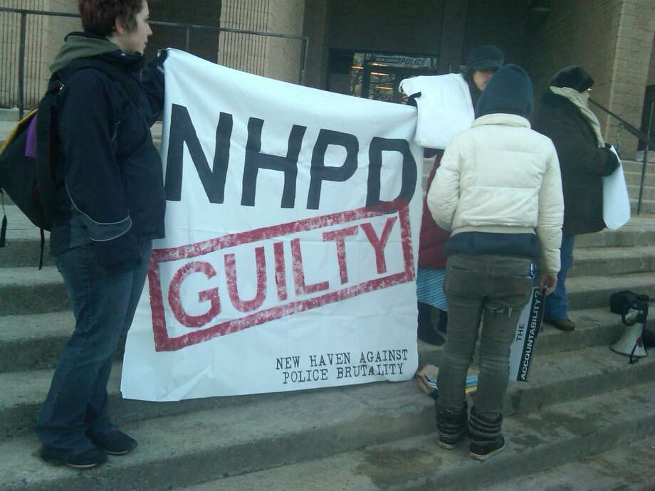 Protesters demonstrate outside police headquarters in New Haven Thursday.