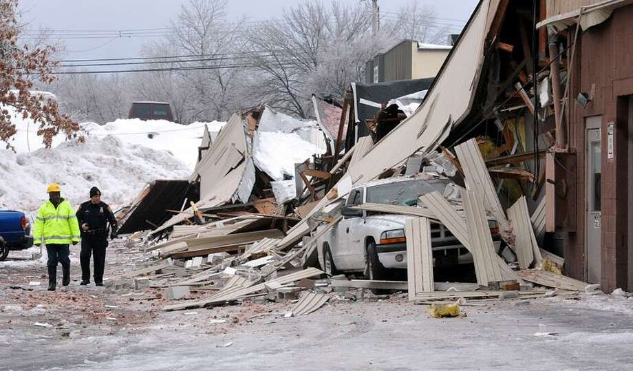 Milford-- The scene of a building collapse that sent several to the hospital and started a large gas leak at 282 Woodmont Road in Milford.  Photo by Peter Casolino/New Haven Register