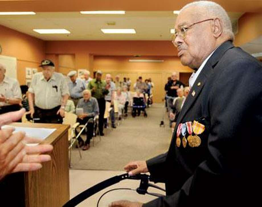 Mitchell gets a standing ovation Saturday from fellow veterans after recieving his overdue medals. (Melanie Stengel/Register)