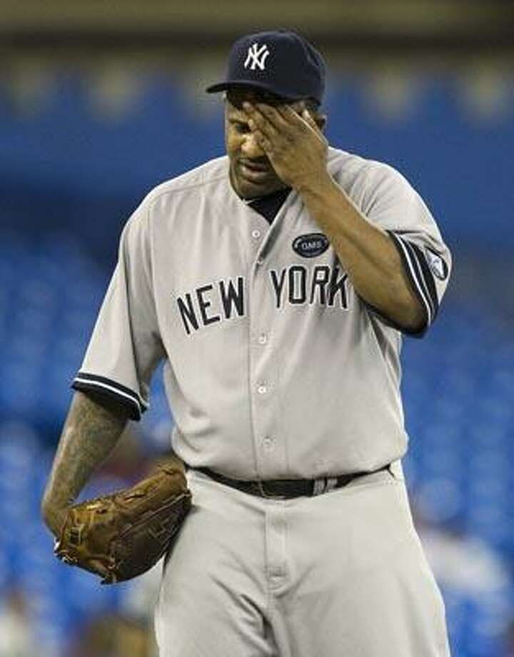New York Yankees starting pitcher CC Sabathia wipes his face while pitching against the Toronto Blue Jays during the first inning of a baseball game in Toronto on Tuesday, Sept. 28, 2010. (AP Photo/The Canadian Press, Nathan Denette) Photo: AP / The Canadian Press