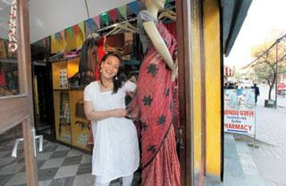 Sushila, a transgender Nepalese, smiles at awomen's clothing store in Katmandu, Nepal. The conservative Hindu nation wants to hold the world's highest same-sex wedding at Everest base camp, to attract the multibillion-dollar gay tourist market to help pull it out of its wrenching poverty. (Associated Press)