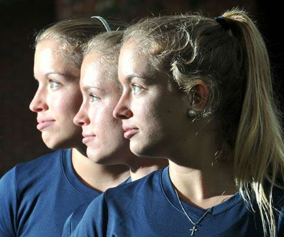 Quinnipiac University Cross Country triplets, the Faust Sisters. From front to back; Christina, Brianna and Amanda. (Photo by Peter Casolino)