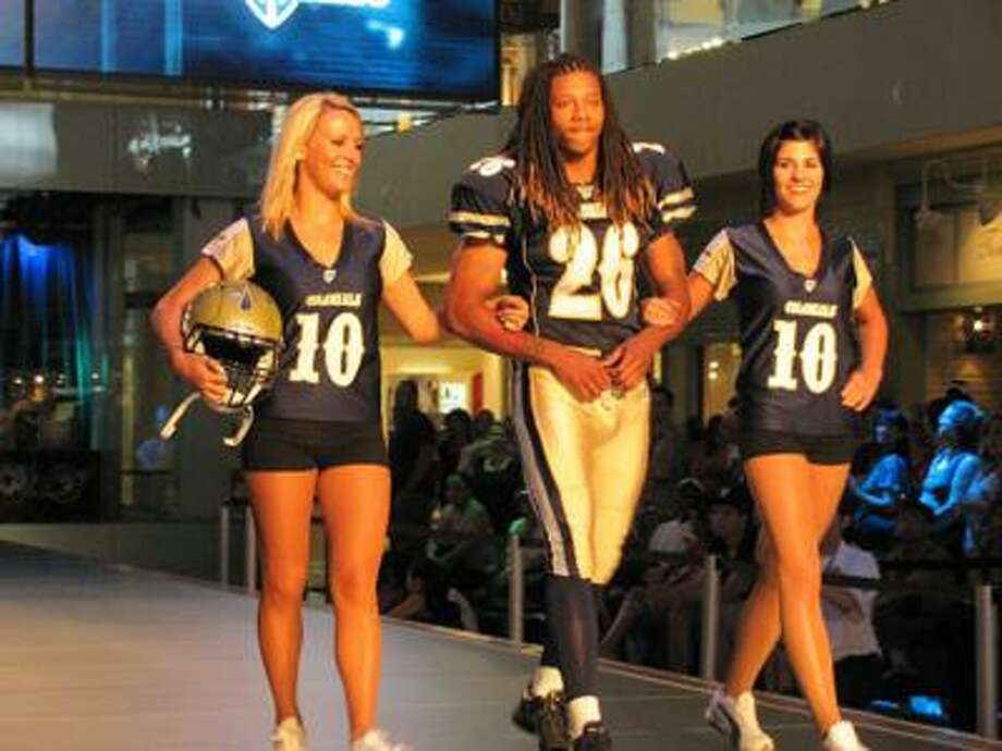 Former UConn star tailback Andre Dixon models the new uniforms for the 2010 Hartford Colonials of the UFL on Wednesday in Las Vegas. (Photo courtesy of Hartford Colonials)