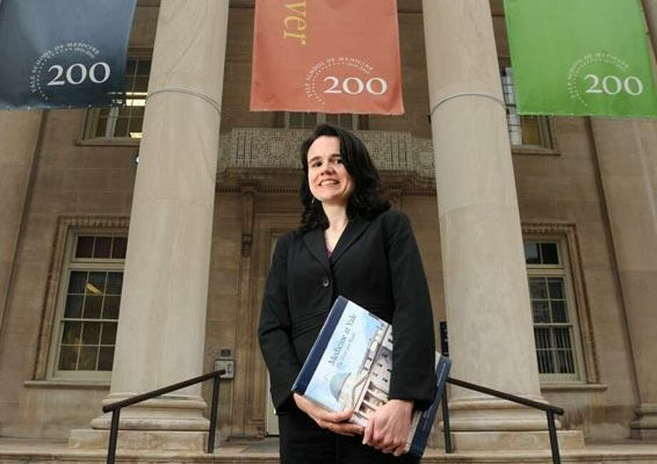 "New Haven--Kerry Falvey, chief of staff to the dean of Yale School of Medicine, has compiled a book entitled ""Medicine at Yale: The First 200 Years."" Photo by Brad Horrigan/New Haven Register-11.23.10."