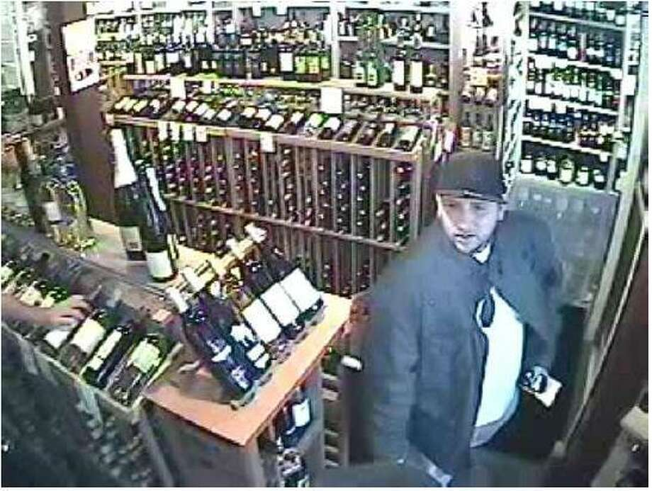 """The man Milford police describe as """"suspect 2"""" in the theft from a South Broad Street liquor store."""