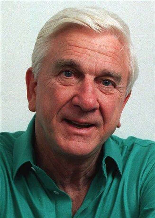 """FILE - This file photo taken in November 1991, shows actor Leslie Nielsen. The Canadian-born Nielsen, who went from drama to inspired bumbling as a hapless doctor in """"Airplane!"""" and the accident-prone detective Frank Drebin in """"The Naked Gun"""" comedies, has died. He was 84. His agent John S. Kelly says Nielsen died Sunday, Nov. 28, 2010, at a hospital near his home in Ft. Lauderdale, Fla., where he was being treated for pneumonia. (AP Photo/Doug Pizac, file) Photo: AP / AP1991"""