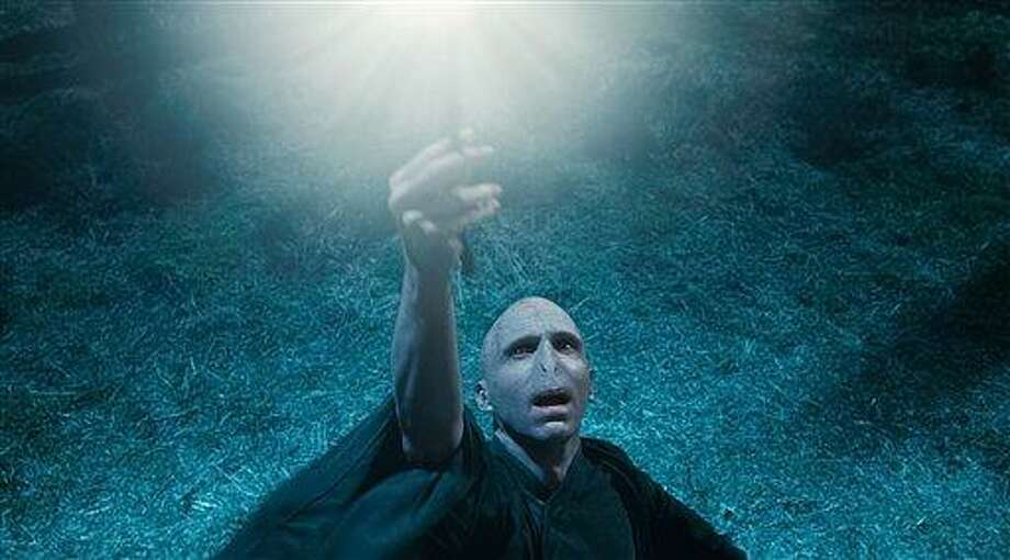 """In this film publcity image released by Warner Bros. Pictures, Ralph Fiennes is shown in a scene from """"Harry Potter and the Deathly Hallows: Part 1."""" (AP Photo/Warner Bros. Pictures) Photo: AP / Warner Bros. Pictures"""