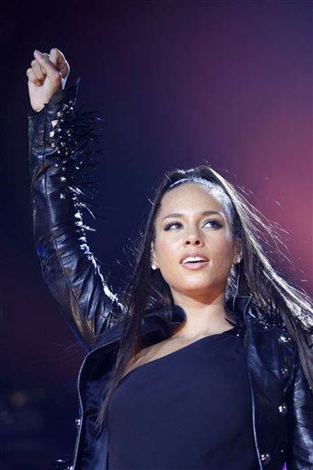 FILE - In this May 9, 2010 file photo, U.S. singer Alicia Keys performs on stage at the Festhalle in Frankfurt am Main, Germany. (AP Photo/Mario Vedder, file) Photo: AP / AP2010
